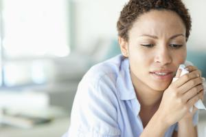 Crying woman holding tissue