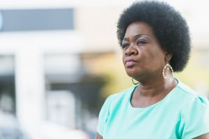 Head and shoulders of serious mature black woman