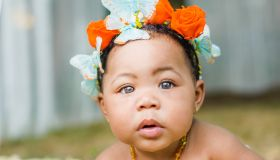 Portrait of baby girl wearing butterflies and flowers in her hair
