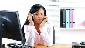Worried black businesswoman at desk