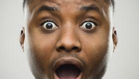 Close-up portrait of shocked man