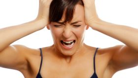 Young woman holding her head and screaming Mary Ann Lannon Florida woman