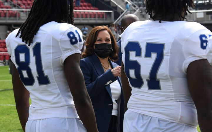 US Vice President Kamala Harris Applauds After Tossing The Coin